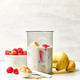 fresh banana, berries and milk in blender container - PhotoDune Item for Sale