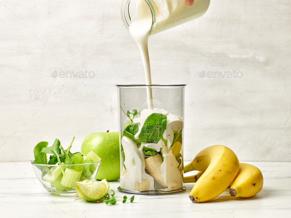 cook adding yogurt into blender container - Stock Photo - Images