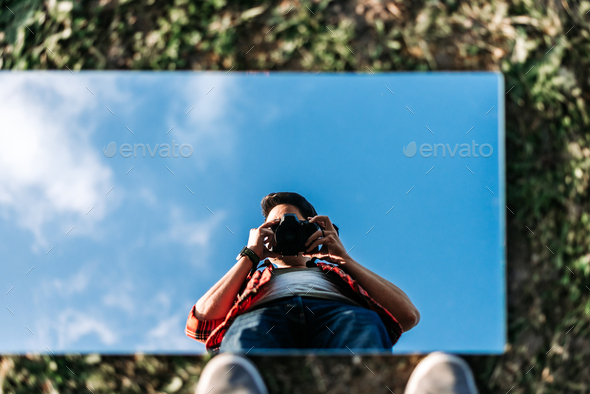 Young photographer taking a selfie - Stock Photo - Images