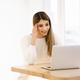 Happy sfemale blogger laughing while chatting with friends in social networks on laptop device - PhotoDune Item for Sale