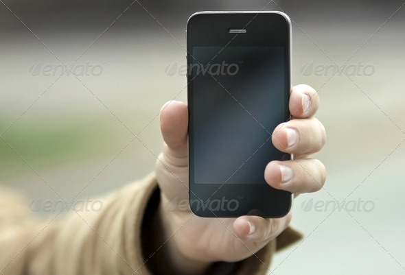 Phone at hand - Stock Photo - Images