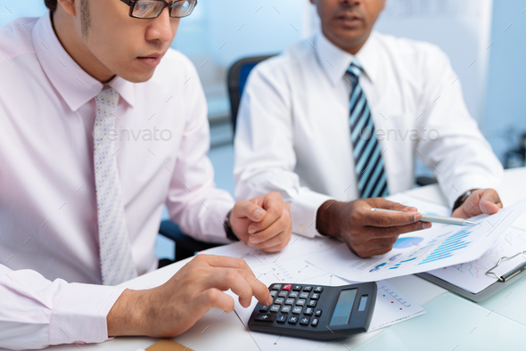 Working on report - Stock Photo - Images
