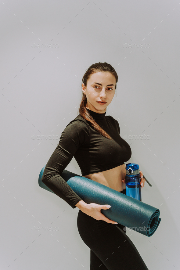 Beautiful sportive woman training in a gym - Stock Photo - Images