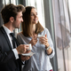 Beautiful young couple talking to each other and smiling while enjoying coffee - PhotoDune Item for Sale