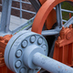 Close-up of a large orange mechanical part - PhotoDune Item for Sale