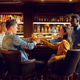 Four cheerful friends drinks beer in bar - PhotoDune Item for Sale