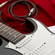 Black electric guitar, red background, nobody - PhotoDune Item for Sale