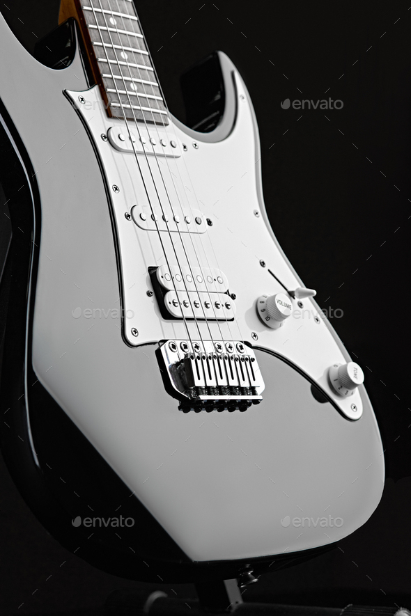 Modern electric guitar, black background, nobody - Stock Photo - Images