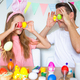 Father and his little daughter painting eggs. Happy family preparing for Easter - PhotoDune Item for Sale