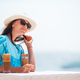 Young woman drinking cold coffee enjoying sea view - PhotoDune Item for Sale