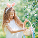Adorable little girl in blooming apple garden on beautiful spring day - PhotoDune Item for Sale