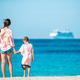 Beautiful mother and daughter at Caribbean beach enjoying summer vacation - PhotoDune Item for Sale
