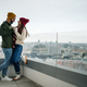 Young couple owners with coffee on balcony in new flat, moving in, new home and relocation concept - PhotoDune Item for Sale