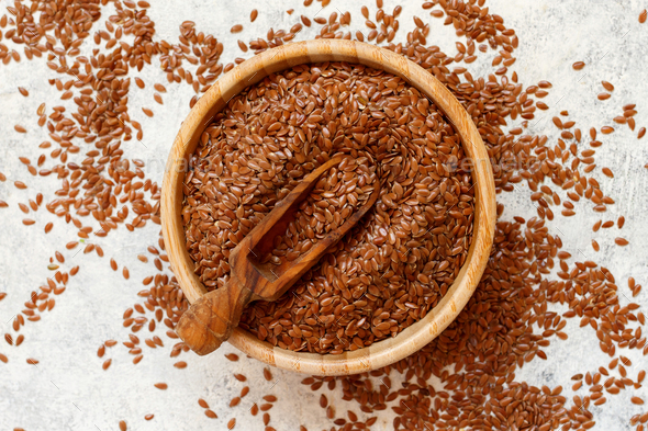 Raw Flax seeds in a bowl - Stock Photo - Images