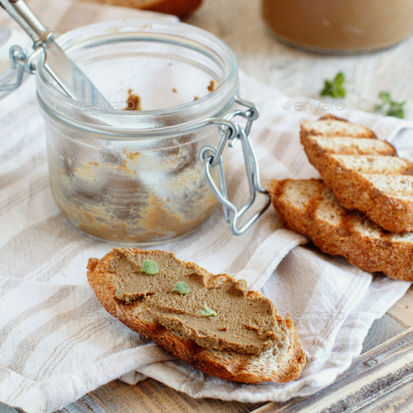 Making sandwiches with homemade pate - Stock Photo - Images
