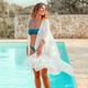 Young woman in swimsuit and white cover up - PhotoDune Item for Sale