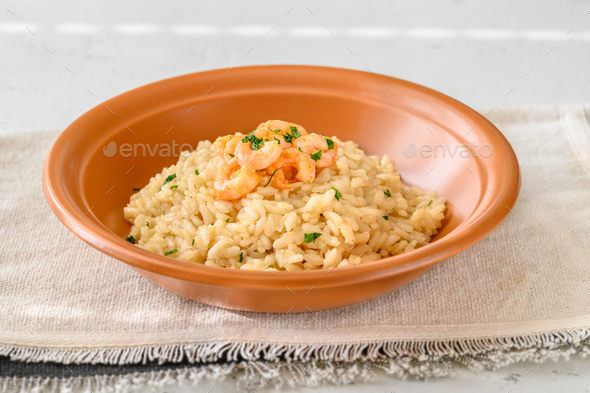 Portion of risotto with prawn - Stock Photo - Images