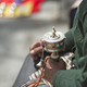 Old woman praying with prayer roll in Lhasa - PhotoDune Item for Sale