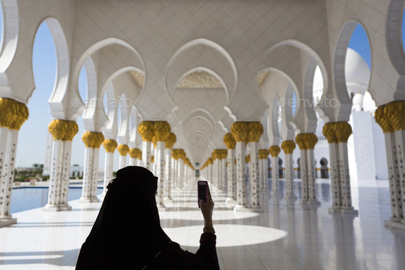 Woman and selfie at Sheikh Zayed Mosque in Abu Dhabi - Stock Photo - Images