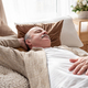 Senior man asleep in bed at home napping after breakfast - PhotoDune Item for Sale