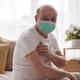 Senior hispanic man wearing face mask showing vaccinated arm. - PhotoDune Item for Sale