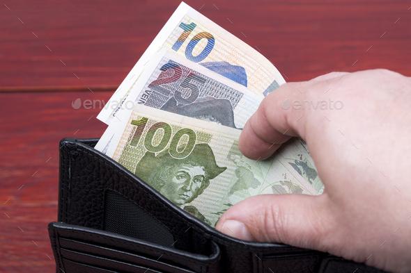 Salvadoran money in a black wallet - Stock Photo - Images