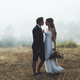 Young bride and groom walking high in mountains. Amazing weather with fog and sun - PhotoDune Item for Sale