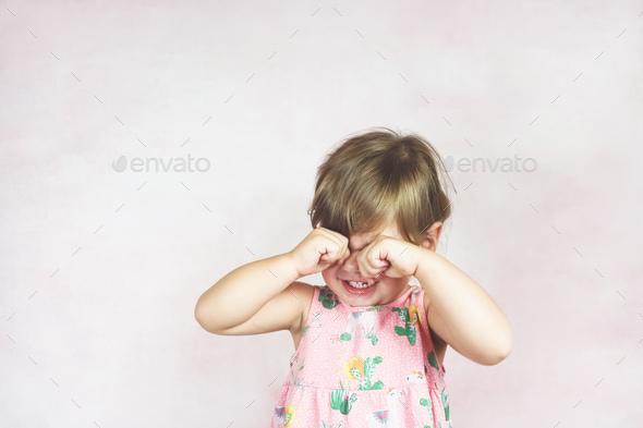 Sad blonde little girl - Stock Photo - Images