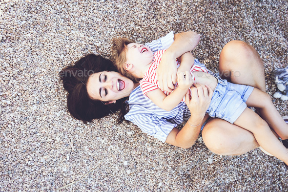 Mom and daughter having fun together in a park - Stock Photo - Images