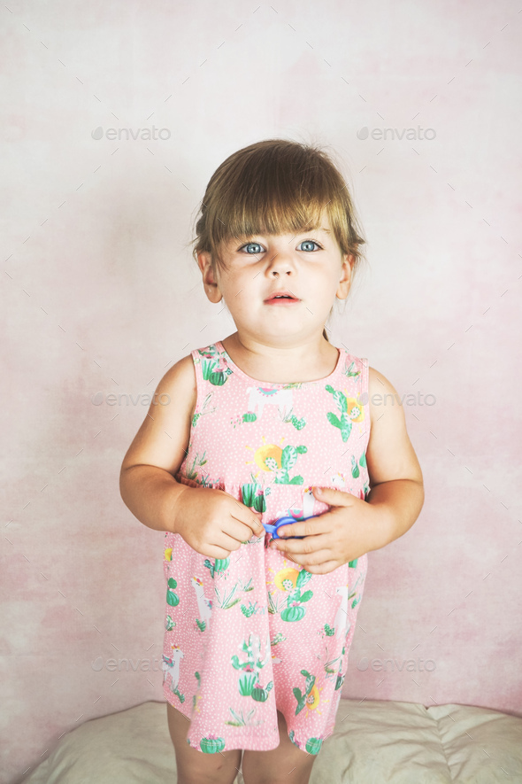 Young little and funny girl in a studio shot - Stock Photo - Images