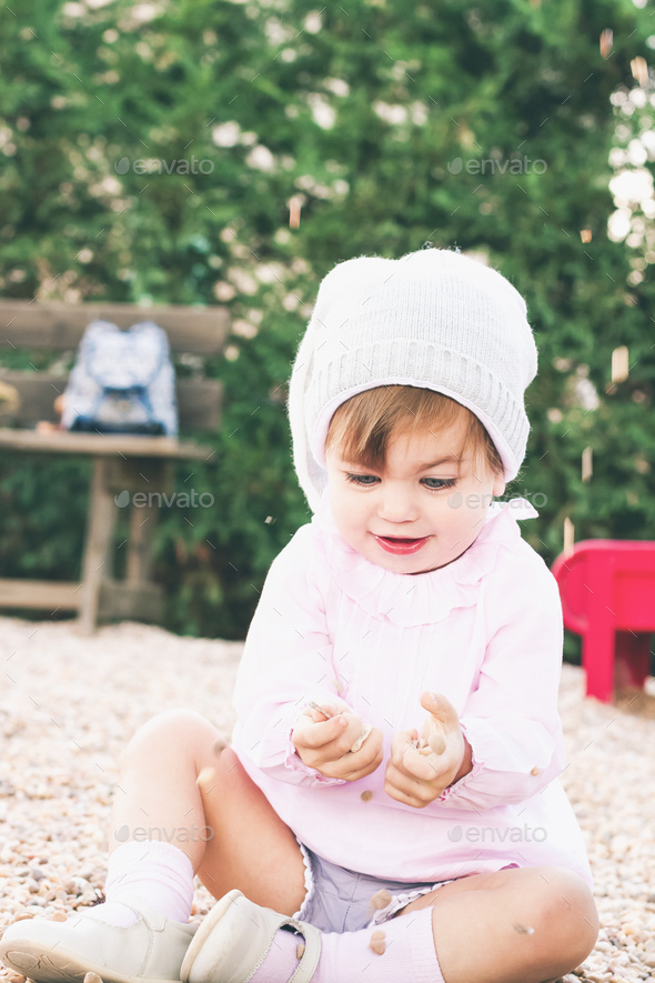 Beautiful portrait of a baby girl with blue eyes - Stock Photo - Images