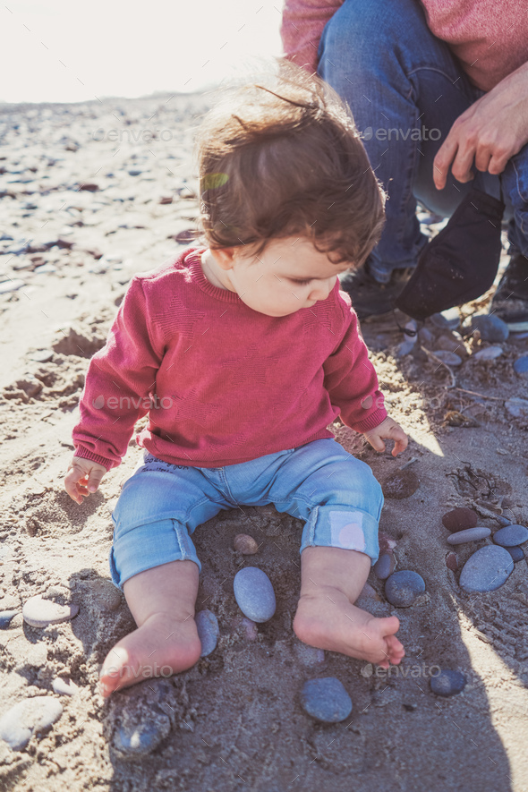 Young dad have a great day at the beach with his dauther - Stock Photo - Images