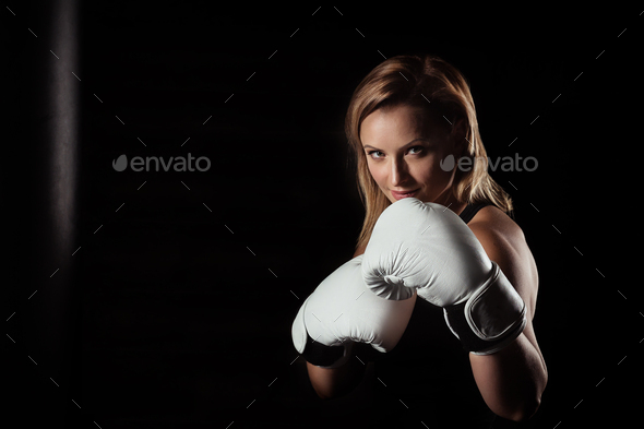 Sporting blonde woman in boxing gloves - Stock Photo - Images