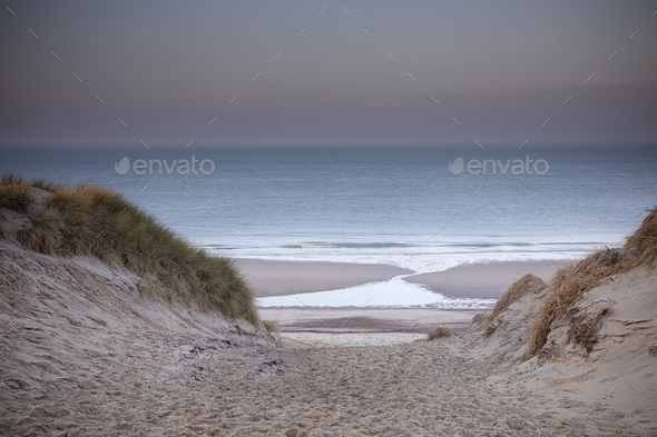 sand dune path to sea beach at dusk - Stock Photo - Images