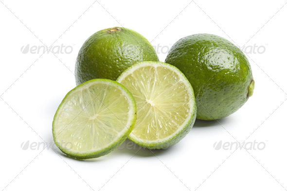 Whole and sectioned fresh limes - Stock Photo - Images