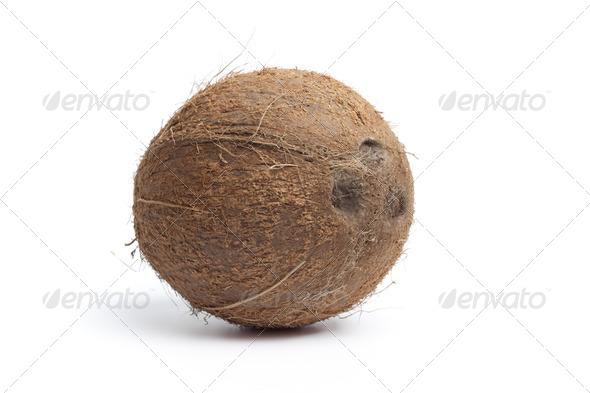 Whole single fresh coconut - Stock Photo - Images