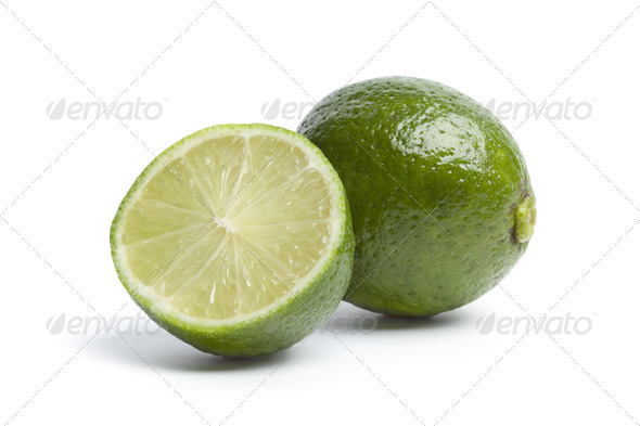 Whole and a half fresh lime - Stock Photo - Images