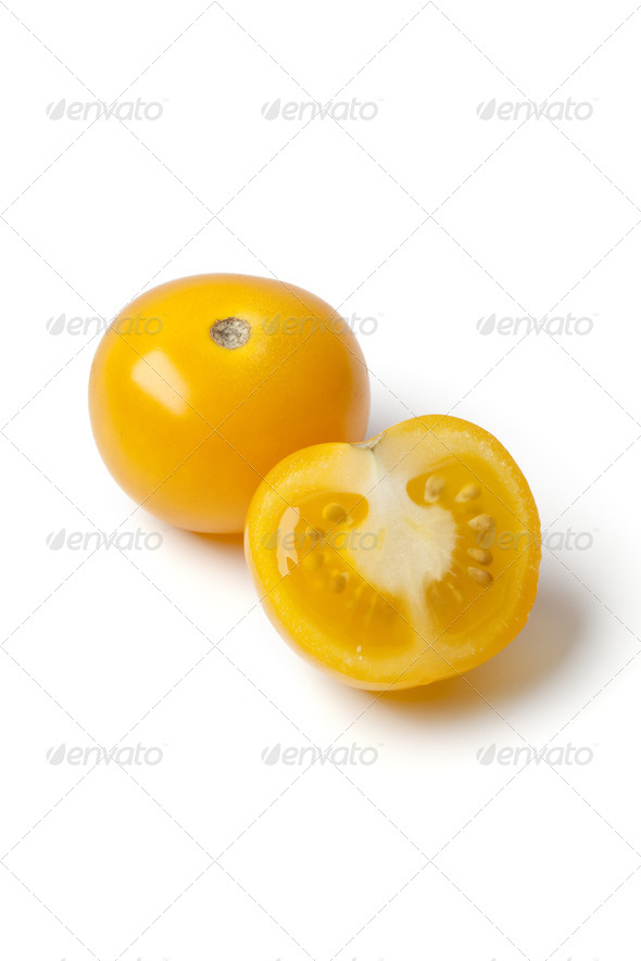 Whole and half yellow tomato - Stock Photo - Images