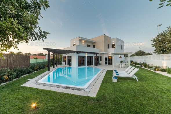 Modern house with garden swimming pool and wooden pergula - Stock Photo - Images