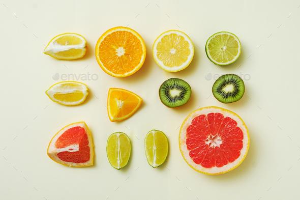 Lemon, orange, lime and grapefruit cut into pieces - Stock Photo - Images