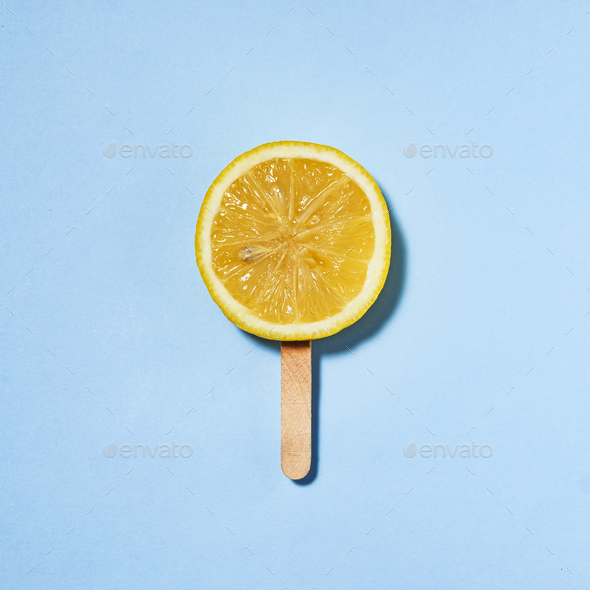 Summer concept lemon on a stick instead of ice cream - Stock Photo - Images