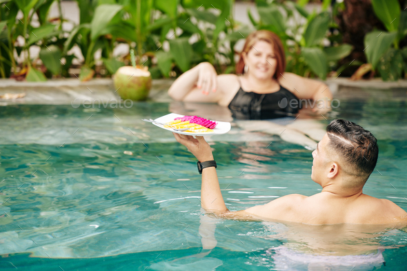 Dating in swimming pool - Stock Photo - Images