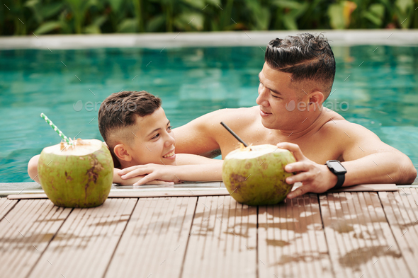 Father and son in swimming pool - Stock Photo - Images