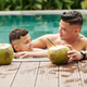 Father and son in swimming pool - PhotoDune Item for Sale