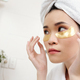 Woman applying undereye patches - PhotoDune Item for Sale