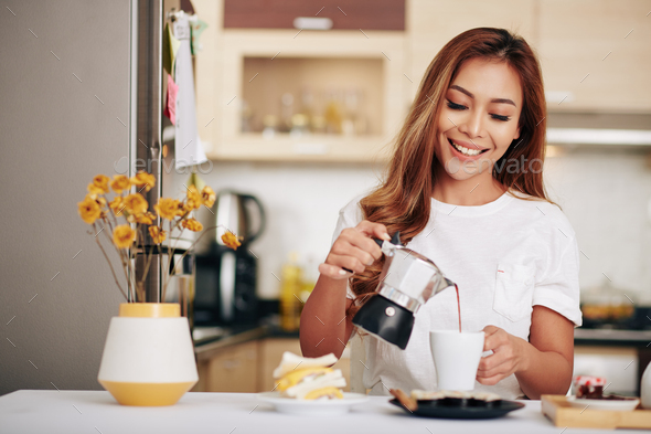 Woman making herself breakfast - Stock Photo - Images