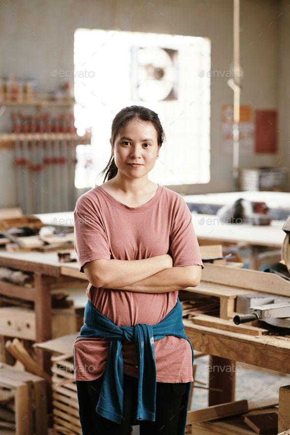 Young female carpenter - Stock Photo - Images