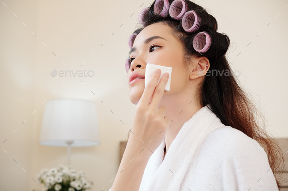 Young woman removing make-up - Stock Photo - Images