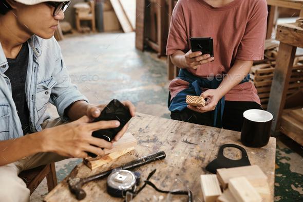 Carpenter phototgraphing wooden blocks - Stock Photo - Images