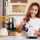 Woman making herself breakfast - PhotoDune Item for Sale